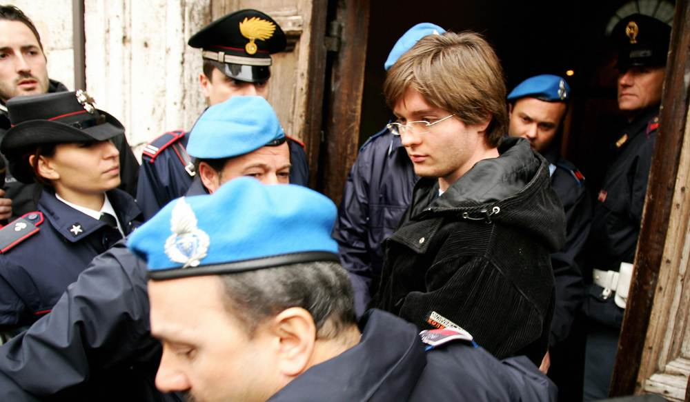 Raffaele Sollecito with Italian Police